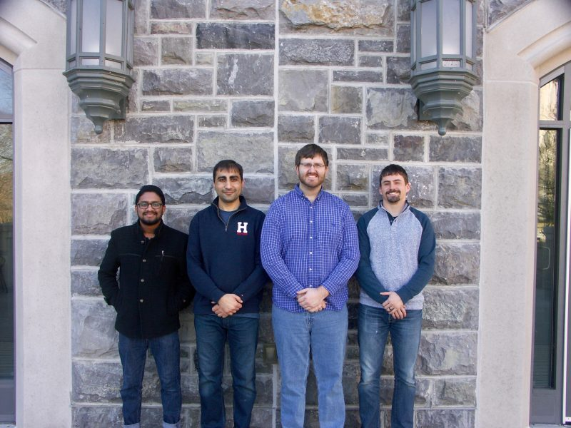Photo shows the four Spring 2019 Graduate School Doctoral Assistantship Awardees in front of a Hokie Stone background